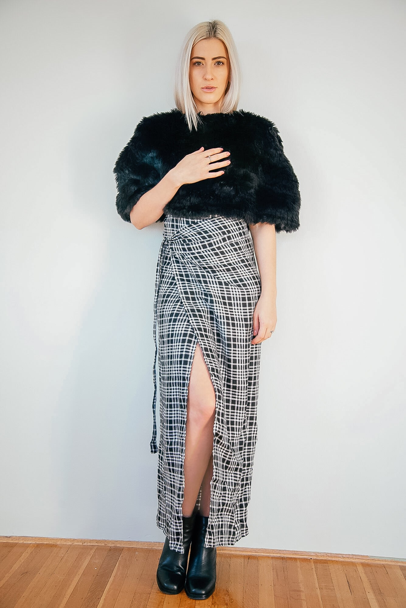 Kim Legler - black faux fur capelet, long grey checkered wrap skirt