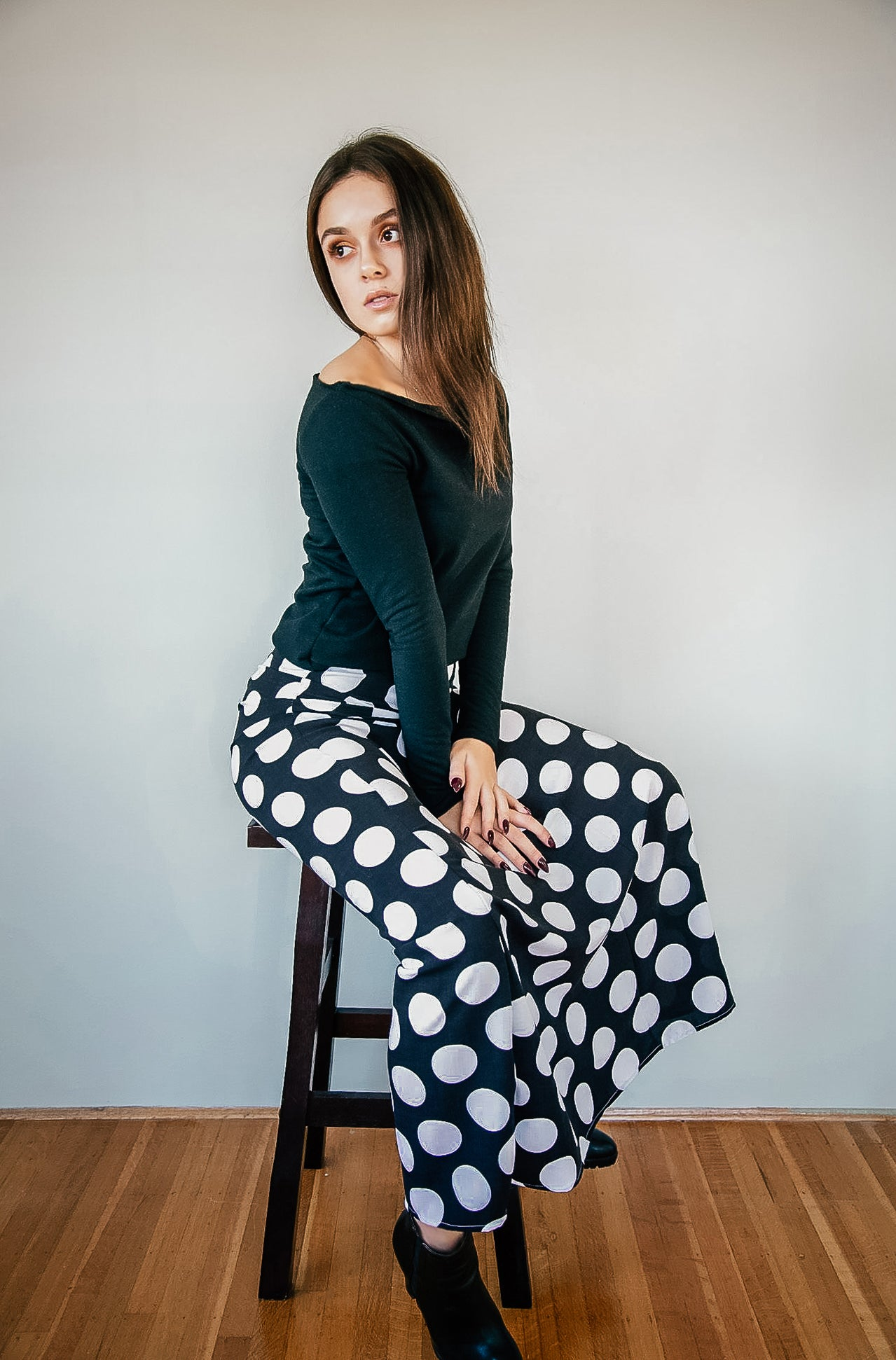 Samia Oz for Kim Legler - Wearing long polka dot skirt and black cold shoulder top