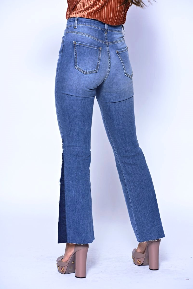 Mid Wash Flared Jeans With Triangle Insert And Frayed Edge