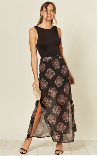 Black sheer maxi skirt with mini skirt lining underneath and paisley print design along with side splits and side zip fastening