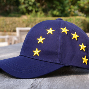 EUROPEAN Stars Cap overview on wooden surface with garden background