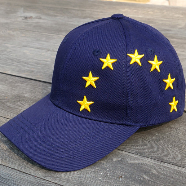 EUROPEAN Stars Cap closer up on wooden surface with garden background