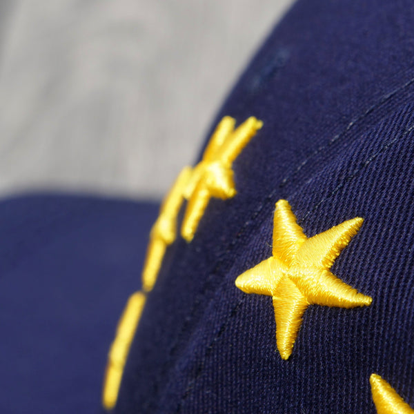 EUROPEAN Stars Cap close up from the right wooden surface with garden background