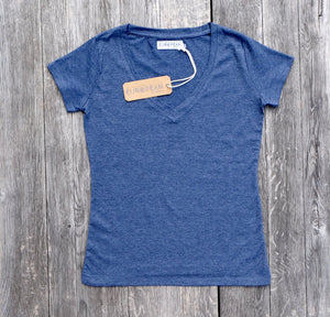 EUROPEAN V neck T-Shirt for women with landmarks overview from the front of landmarks on wooden background with hangtag and neck label in focus
