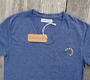 EUROPEAN T-Shirt with small stars embroidered next to pocket UNISEX overview from the front with hang #europeanbychoice hangtag and neck label attached to shirt portrayed on wooden background
