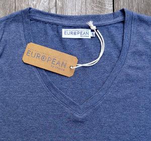 EUROPEAN V neck T-Shirt for women with landmarks closer up of landmarks on wooden background with hangtag and neck label in focus