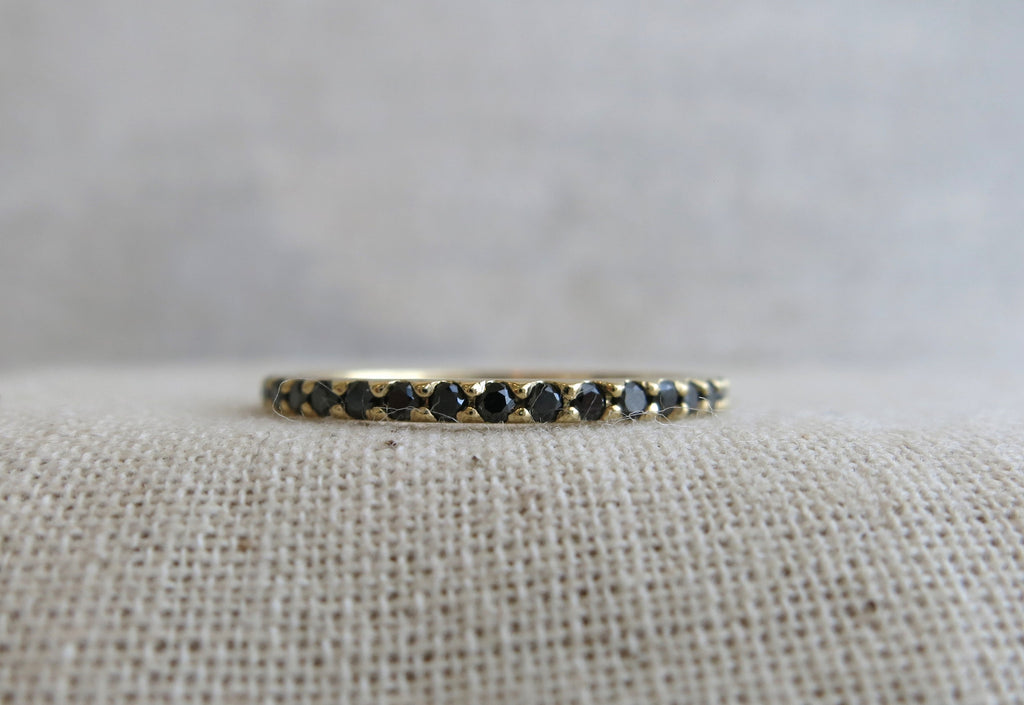 Floating Black Diamond Eternity Band
