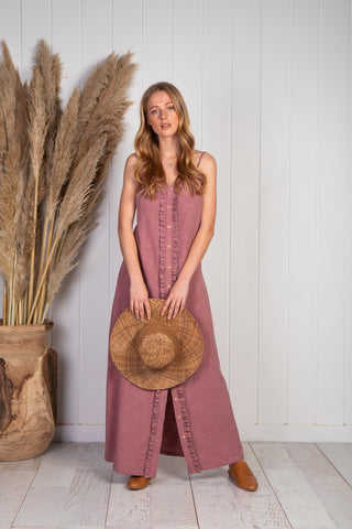 Meraki long maxi dress in mauve with adjustable thin straps, wooden buttons going down ruffle detail all the way down to the hem, small ruffle detail on bust going all the way around, textured natural cotton