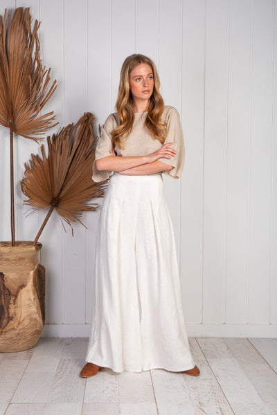 Riviera wide leg cream linen palazzo pants with high waist and invisible zip at back, two pleats going down either front leg. unlined