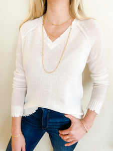 Cashmere Distressed V-Neck Sweater in White