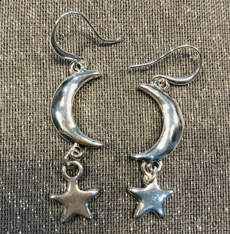 Silver tone star and moon drop earrings