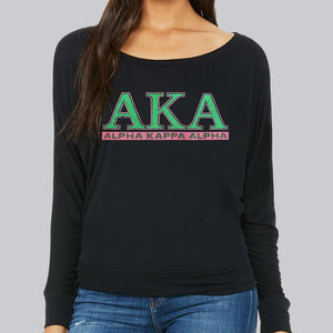 AKA long sleeve off shoulder glitter t-shirt