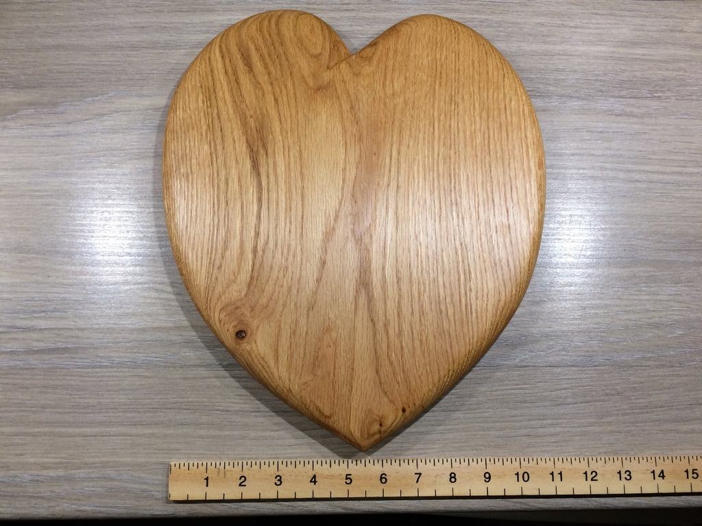 Medium heart shaped oak chopping or cheese board.