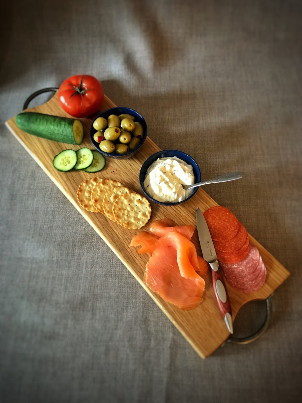 Large oak antipasti serving board with vintage cast iron handles