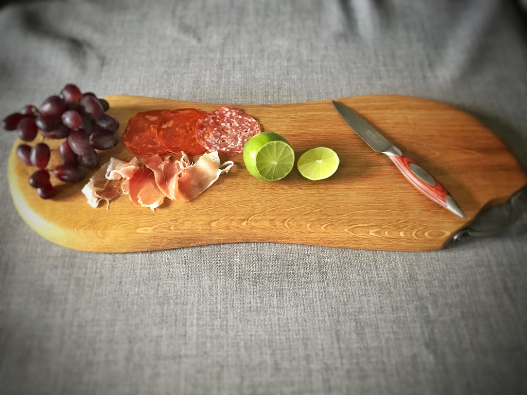 Large curved Oak antipasti serving board with cast iron handles