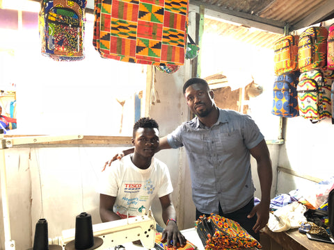 Afrisocks CEO, Huzaif, with Madi, in his new shop