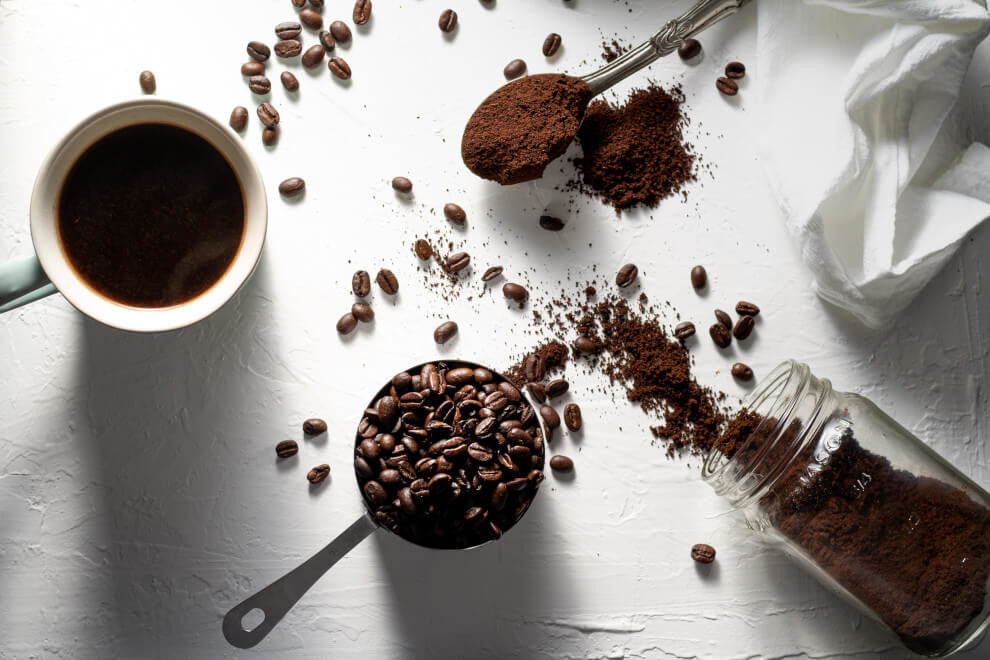 cacao powder and coffee beans on a white background