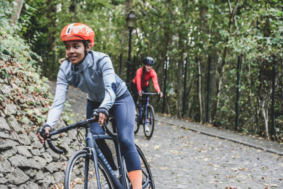 cacao enhances performance: two women cycling | To'ak Chocolate