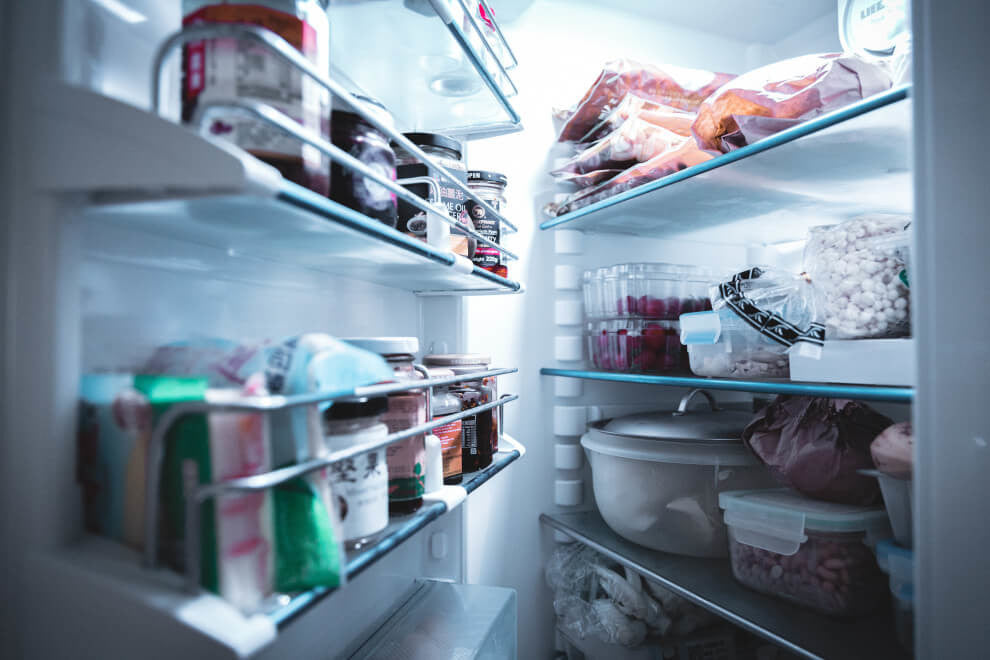 an open fridge with all the shelves occupied