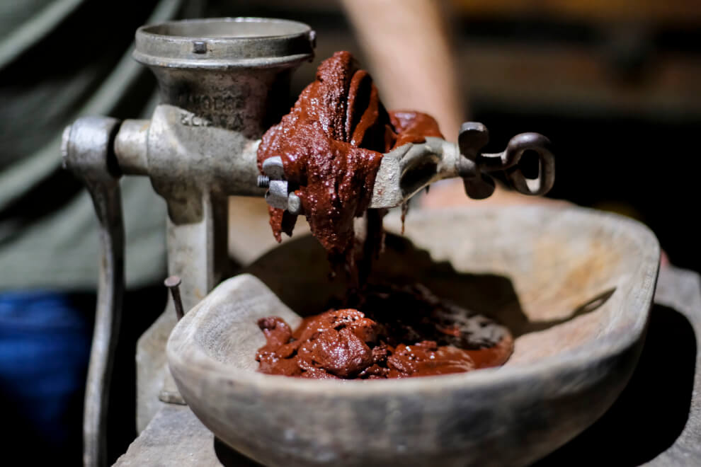 Melanger: a stone grinder containing crushed cacao nibs