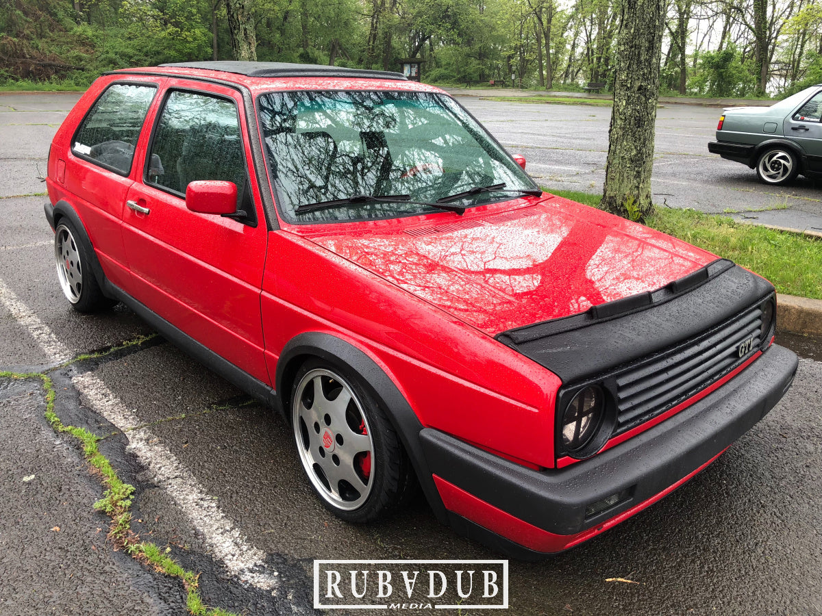 red mk2 golf on porsche d90