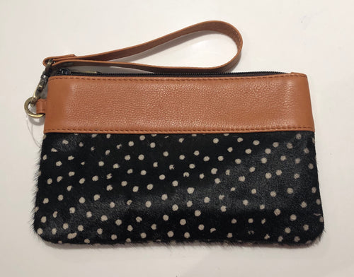Polka hairon and tan leather clutch