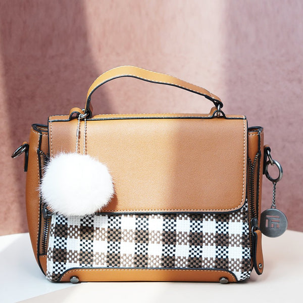 Geometric Patterned Handheld Bag with an attached Pompom