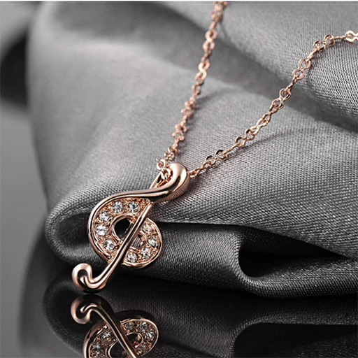 Necklace with Treble clef pendant - zinc alloy gold plated with Austrian crystal stones