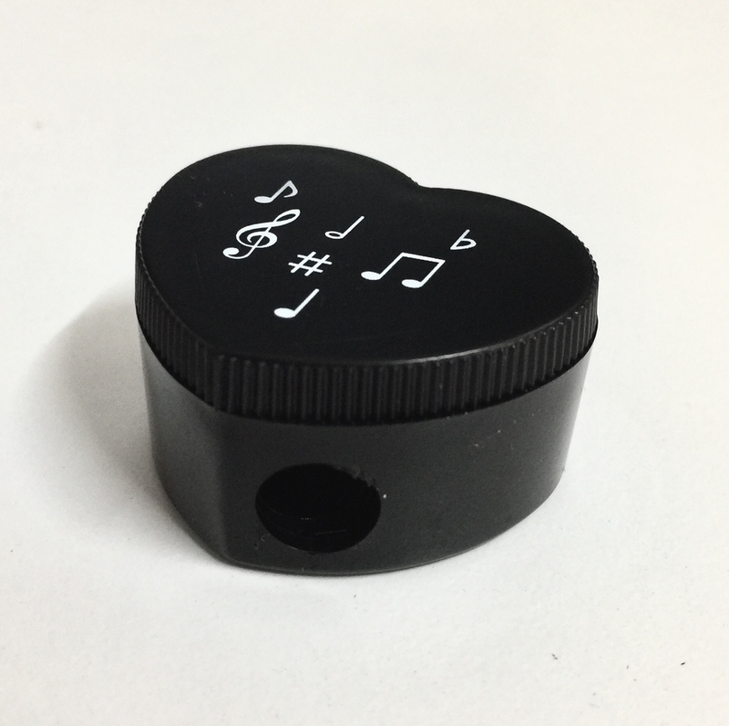 Heart Shaped Sharpener Black with notes & clefs.