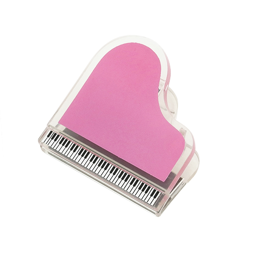 Magnetic paper clip in the shape of a grand piano. Pink