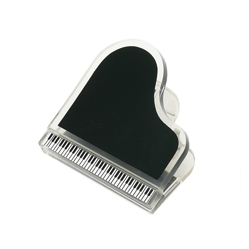 Magnetic paper clip in the shape of a grand piano. Black