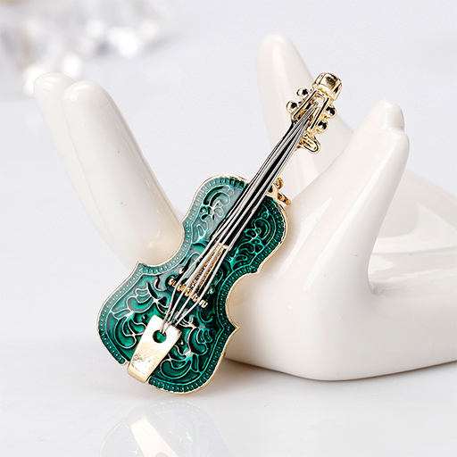 Brooch - violin green with gold tailpiece,scroll & pegs.