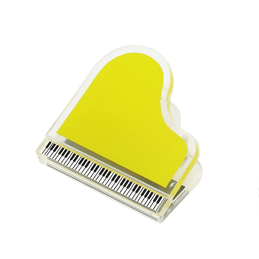 Magnetic paper clip in the shape of a grand piano. Yellow
