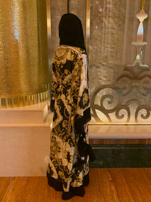Beautiful silk abaya in black and gold. Designer inspired print. Modest item with matching hijab.