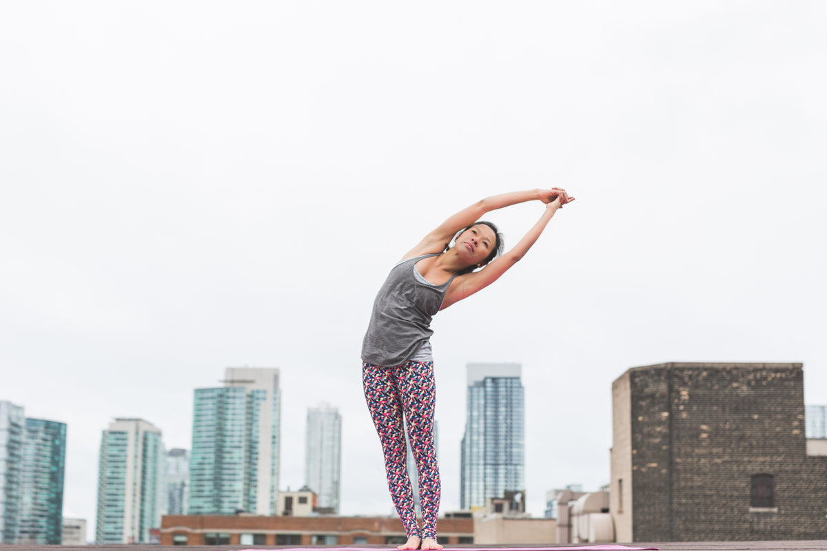 Woman stretching in yoga poses to promote healthy essential oil use