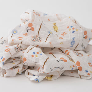 single swaddle blanket with different pieces of candy on it