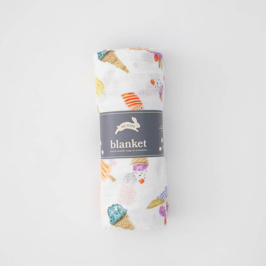 single swaddle blanket with ice cream cones, banana splits, and other frozen treats rolled in Red Rover packaging