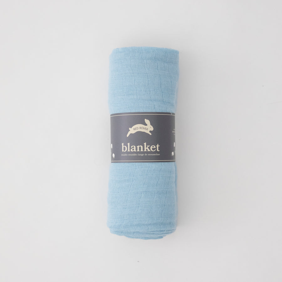 light blue single swaddle blanket rolled up in Red Rover packaging