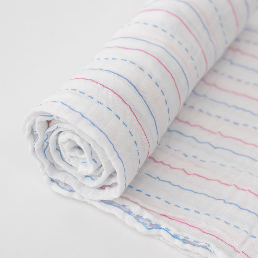 single swaddle blanket made to looking like a piece of paper with blue and red lines