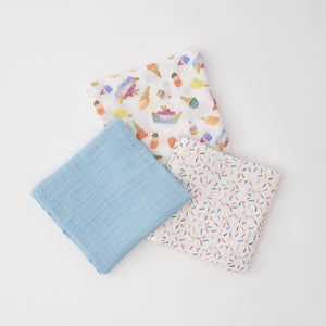 3 swaddle blankets featuring ice cream cones and banana splits, light blue blanket, and sprinkles pattern