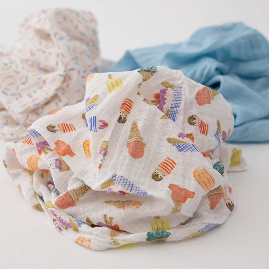 3 swaddle blankets focusing on the ice cream parlor print with different colors of ice cream