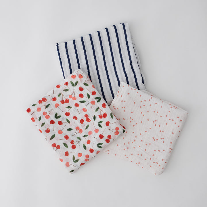 3 swaddle blankets they are cherries, navy and white stripes, cherry blossom petals