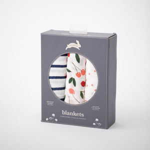 3 swaddle blankets they are cherries, navy and white stripes, cherry blossom petals. All in Red Rover packaging