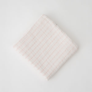 single swaddle blanket with pink crossed stripes on a white background