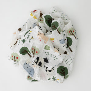 single swaddle blanket with farm animals including cows, sheep, chickens, goats and other animals