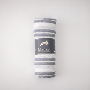 single swaddle blanket with double grey stripes on a white background rolled in Red Rove packaging