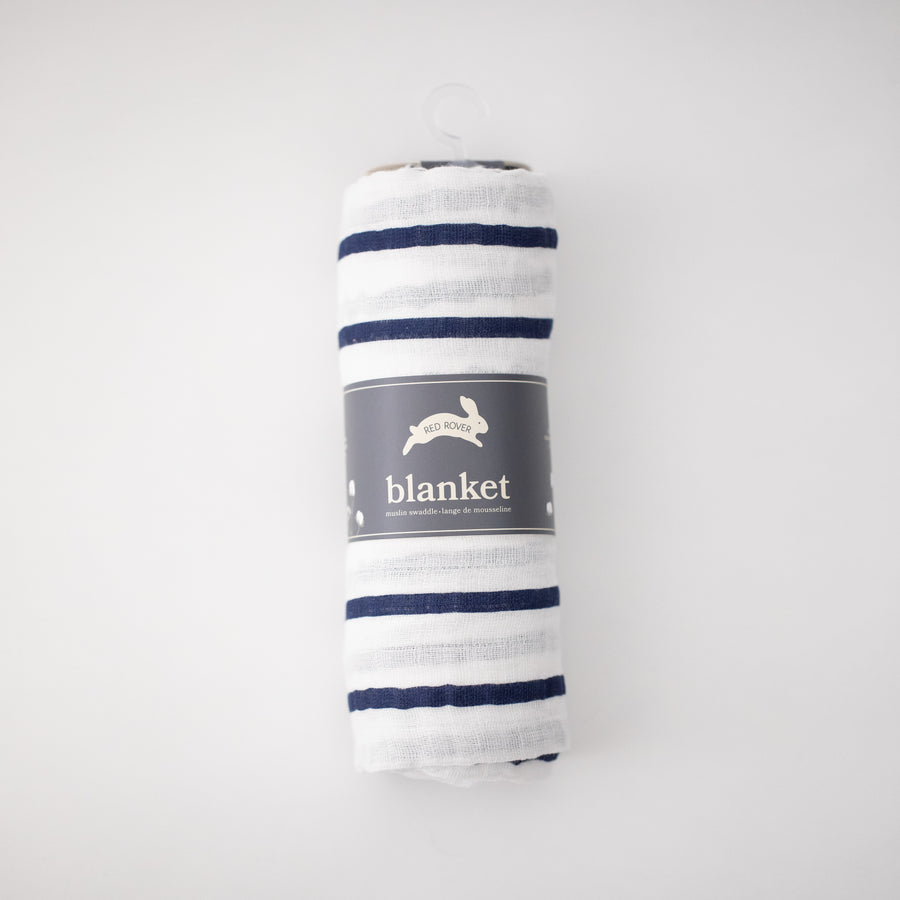 single swaddle blanket with navy stripes on a white background rolled in Red Rover packaging