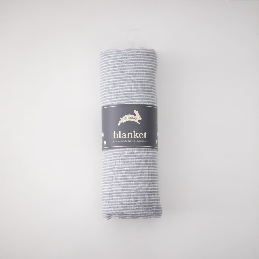 single swaddle blanket with very small grey stripes rolled in Red Rover packaging