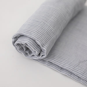 single swaddle blanket with very small grey stripes