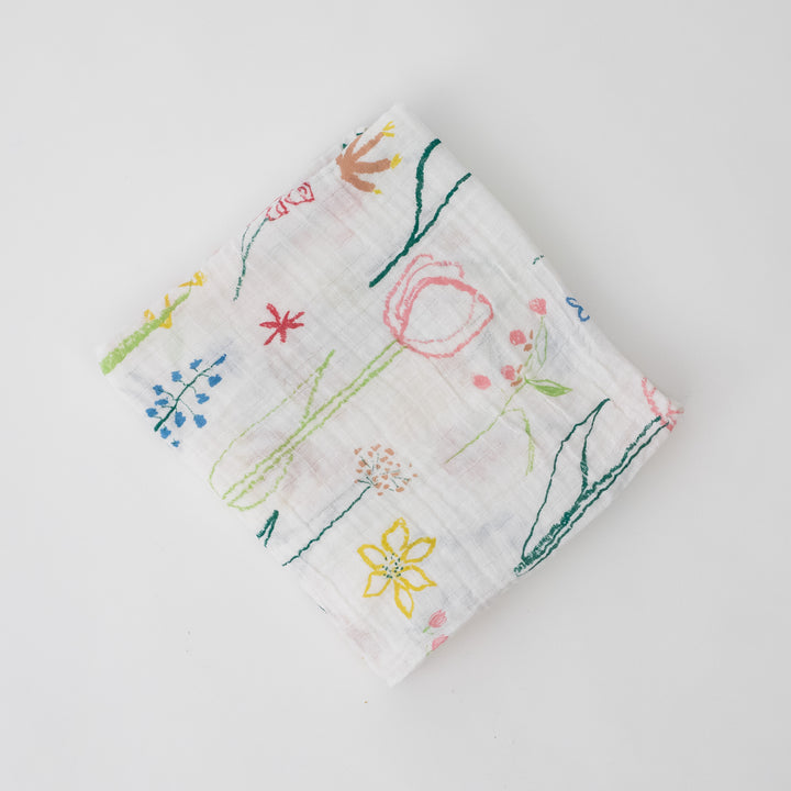 single swaddle blanket with colorful flowers on a white background